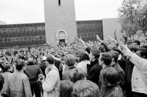 Student protestors mock police oficers by giving the sieg heil nazi salute during a demonstration near Commerce Hall and the Carillon Tower.