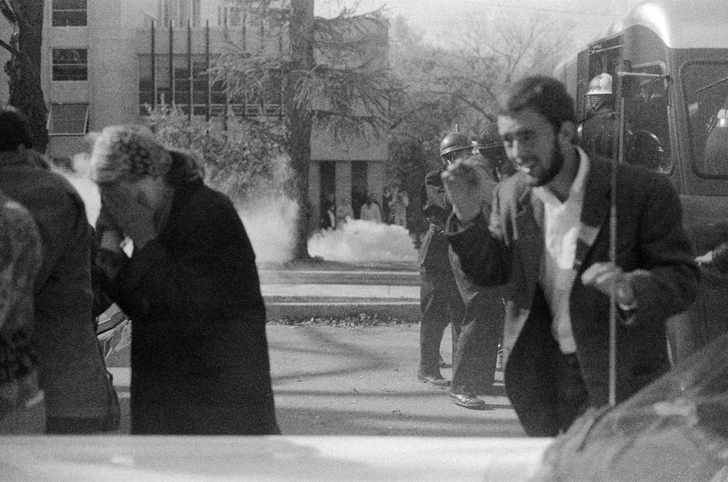Protesters and bystanders shield their faces and run as tear gas canisters go off around them on the UWÐMadison campus on Oct. 18, 1967.