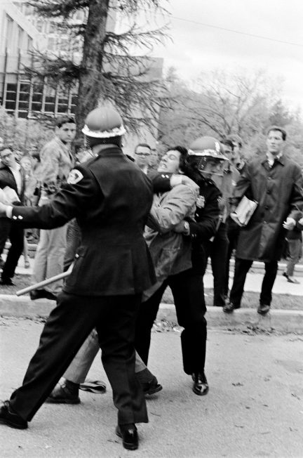 A police officer seizes a demonstrator by the neck during the Oct. 18, 1967, protest against the Dow Chemical Company on the UW-Madison campus.