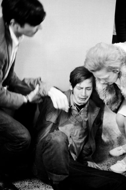 A student in distress is helped by onlookers inside the Commerce Building during the Oct. 18, 1967, protest against Dow on the UW-Madison campus.